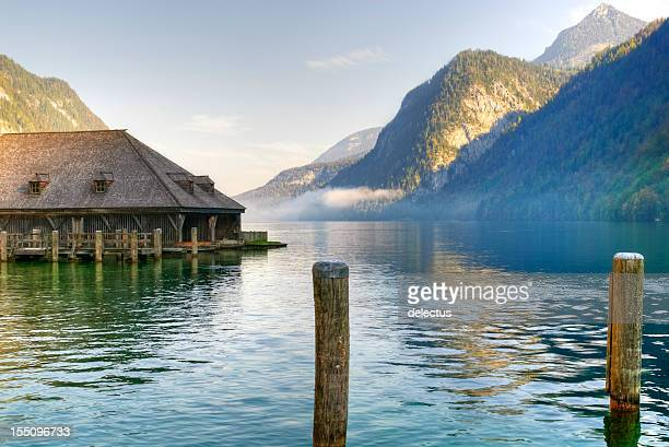 morning mist over the koenigssee - königssee bavaria stock photos and pictures