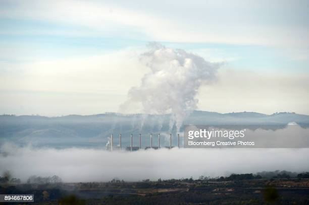 Morning mist surrounds a coal-fired power station