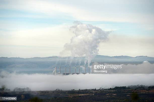 Morning mist surrounds GDF Suez Australian Energy's Hazelwood coalfired power station as steam billows from the facility's smokestacks in Morwell...