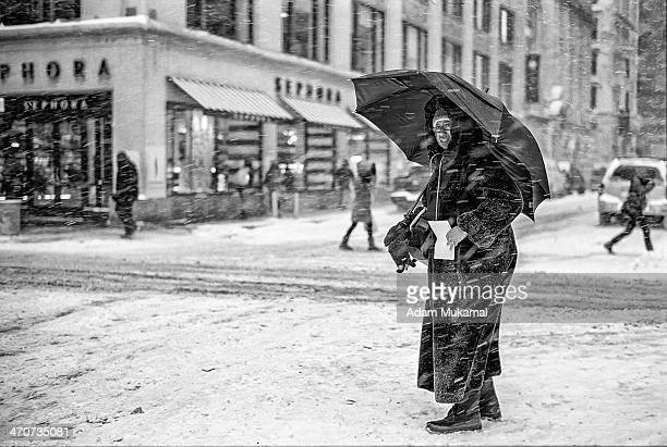 Morning NYC commuter lost in the thick of the ferocious snow blizzard Leica M3, 50mm summilux aspherical, kodak portra 400