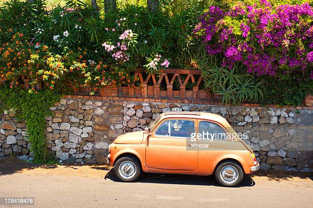 morning of taormina and lovely tiny italian car - taormina stock pictures, royalty-free photos & images