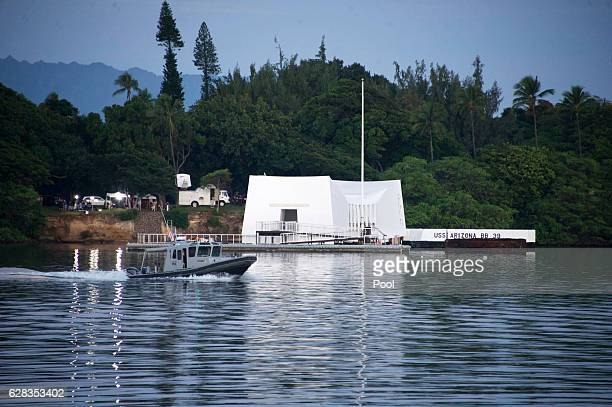 A morning patrol boat goes past the USS Arizona Memorial before a ceremony commemorating the 75th anniversary of the attack on Pearl Harbor at Kilo...