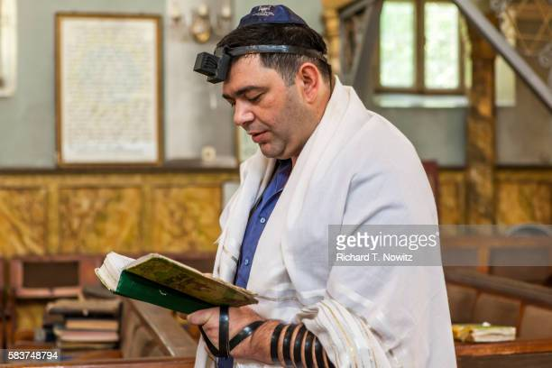 morning prayers in kutaisi synagogue. - jewish prayer shawl ストックフォトと画像