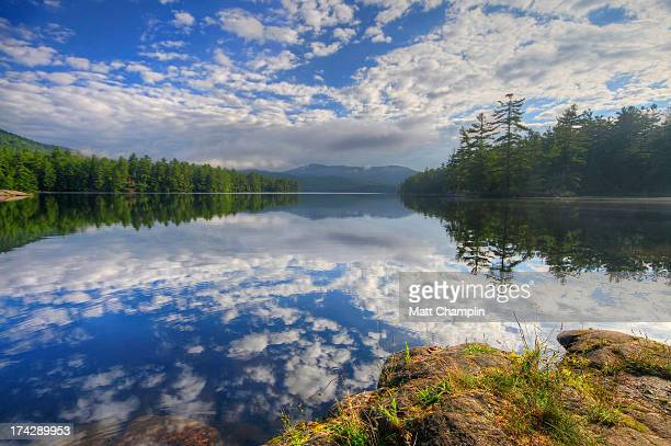 Morning Reflections and Clouds in Mountain Lake