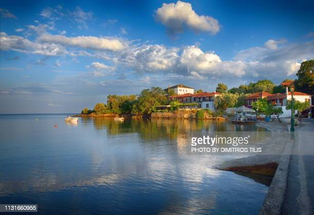 morning reflections at lefokastro - volos stock pictures, royalty-free photos & images