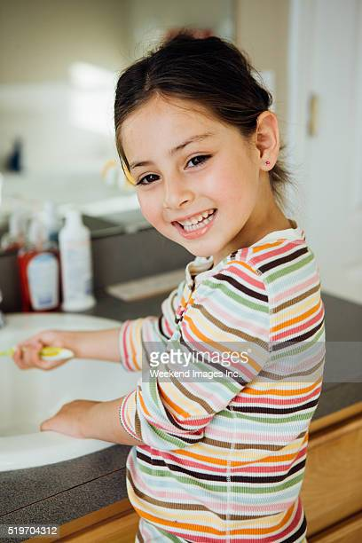 morning routine for toddlers - cute little asian girls stock photos and pictures