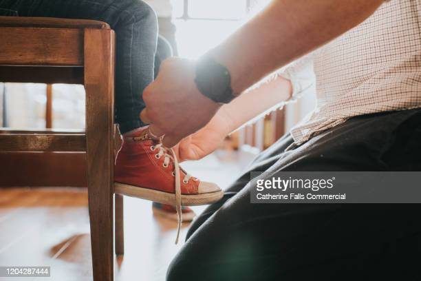 morning routine - shoelace stock pictures, royalty-free photos & images