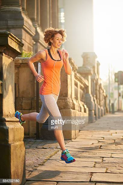 morning run at sunrise - liverpool training stock pictures, royalty-free photos & images