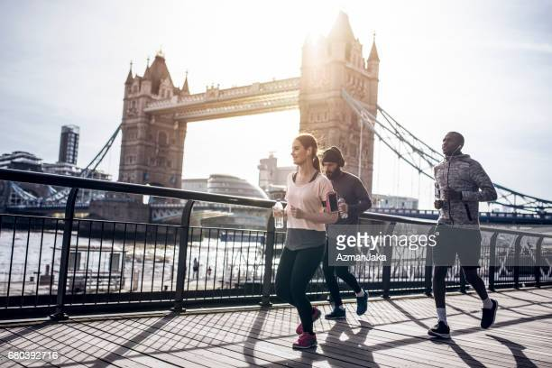 morning run in london - man city stock photos and pictures