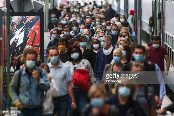 Morning rush hour commuters wear protective face masks after alighting from a train at Gare Du Nord railway station in Paris, France, on Wednesday,...