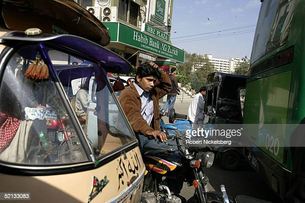 Morning rush hour traffic in downtown Karachi Pakistan January 26 2005 Karachi is one of the world's most populated and fasted growing cities It has...