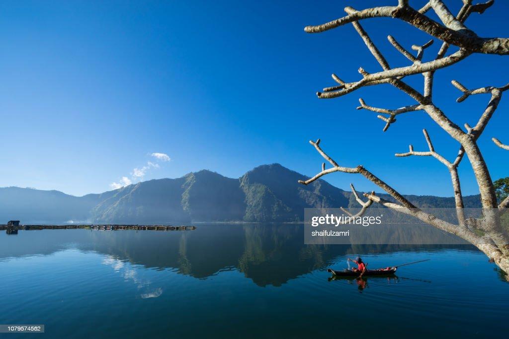 Morning scene of Lake Batur with fisherman daily activity. : Stock Photo