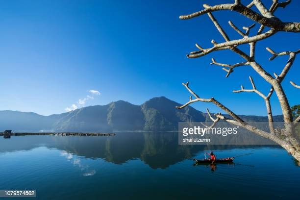 Morning scene of Lake Batur with fisherman daily activity.