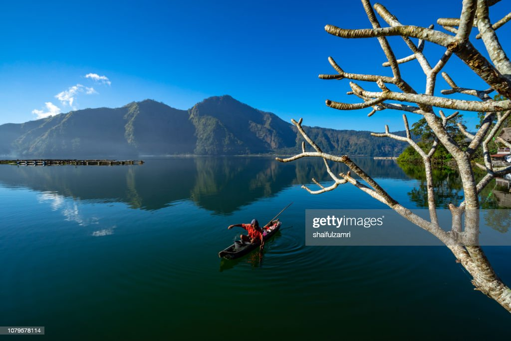 Morning scene of Lake Batur with fisherman daily activity. : Stock Photo