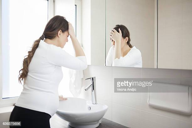 morning sickness - morning sickness stock photos and pictures