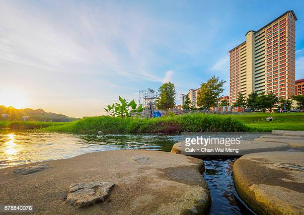 Morning sun and blue sky with man made stream at Bishan Park