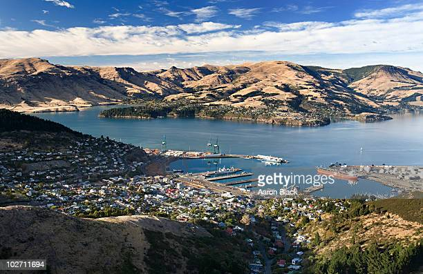 morning sun lights up small port town  - christchurch stock pictures, royalty-free photos & images