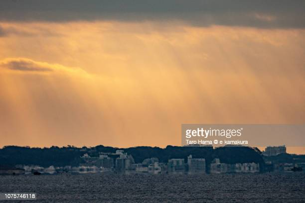 Morning sunbeam on residential buildings and their mirage in Yokosuka cities and Sagami Bay in Kanagawa prefecture in Japan