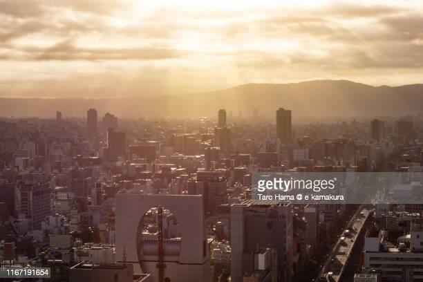 morning sunbeam on the city buildings in osaka - 大阪市 ストックフォトと画像