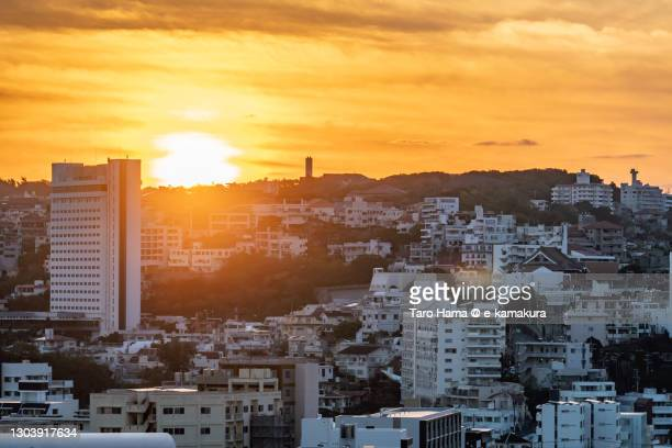 morning sunbeam on the residential district on the hill in naha city of japan - %e... ストックフォトと画像