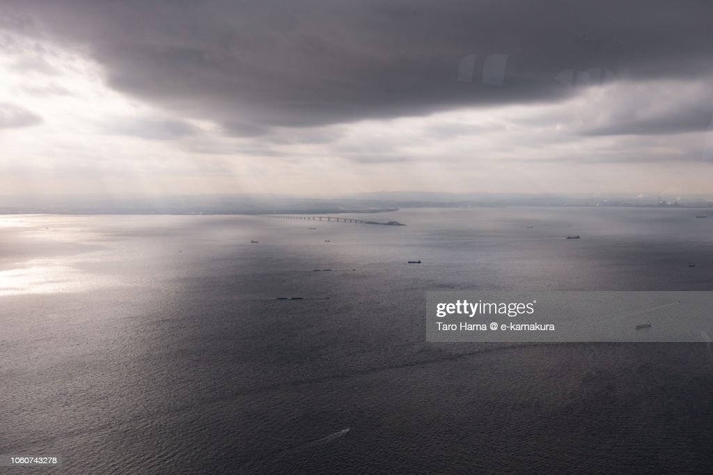 Morning sunbeam on Tokyo Bay in Japan daytime aerial view from airplane : ストックフォト