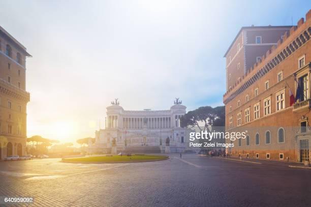 Morning sunlight at Piazza Venezia in Rome, with the Altare della Patria in the background.