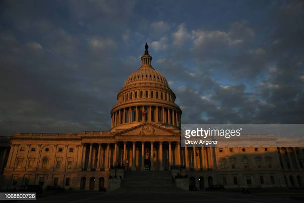 Morning sunlight hits the Capitol dome before the departure of the flagdraped casket of the late former President George HW Bush at the US Capitol...