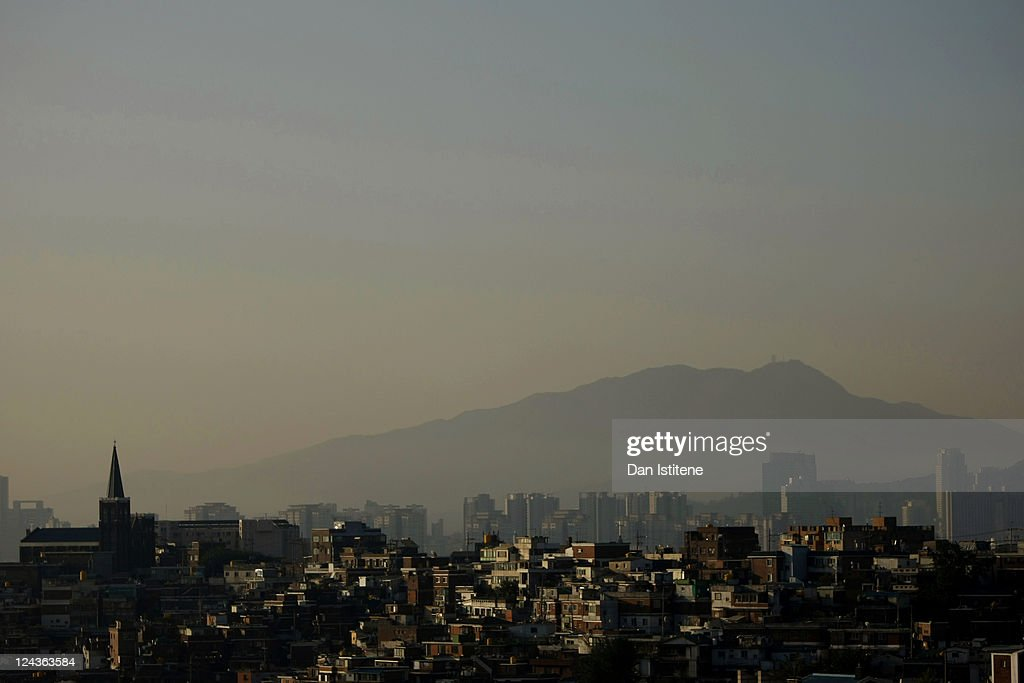 Morning sunlight illuminates residential properties north of the Han River backdropped by mountains and skyscrapers in the Gangnam business district on September 6, 2011 in Seoul, South Korea. The South Korean capital has a population in excess of 10 million with the wider metropolitan area being home to more than 20 million making it one of the largest in the world.