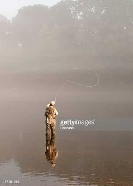 morning sunlight on flyfisherman in the fog - wading stock pictures, royalty-free photos & images