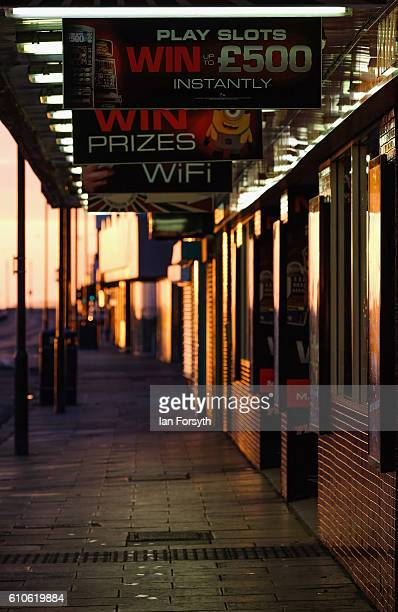 Morning sunlight reflects from shopfronts along Redcar seafront on September 27 2016 in Redcar United Kingdom One year on since the SSI steel making...