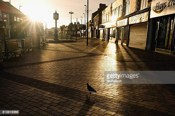 Morning sunlight shines along Redcar high street on September 27 2016 in Redcar United Kingdom One year on since the SSI steel making plant at Redcar...