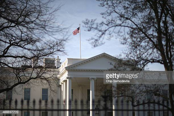 Morning sunlight strikes the flag flying above the White House March 18 2015 in Washington DC The US Secret Service said a letter sent to the White...