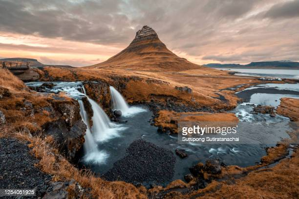morning sunrise landscape of mount kirkjufell with kirkjufellfoss waterfall in iceland. - dramatic landscape stock pictures, royalty-free photos & images