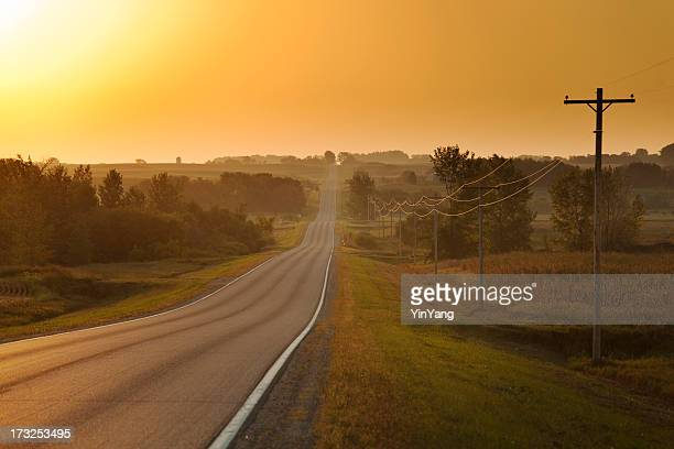 morning sunrise over rural farm country road - minnesota stock pictures, royalty-free photos & images