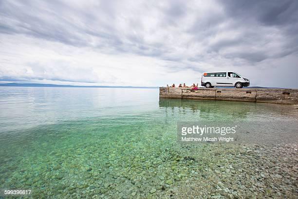 a morning swim in croatia's blue waters. - bucht stock-fotos und bilder