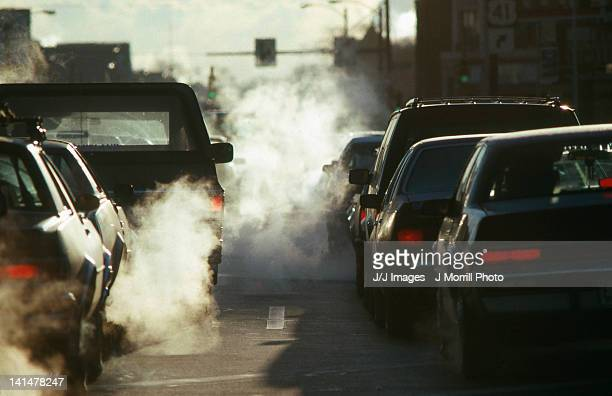 morning traffic in winter - fumes stock photos and pictures