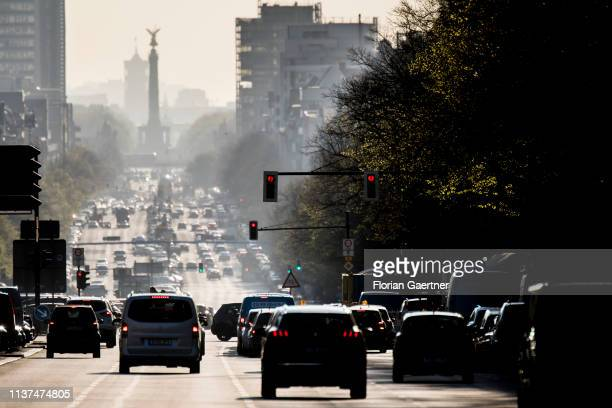 Morning traffic is pictured in front of the Victory Column at the street Bismarckstrasse on April 16 2019 in Berlin Germany