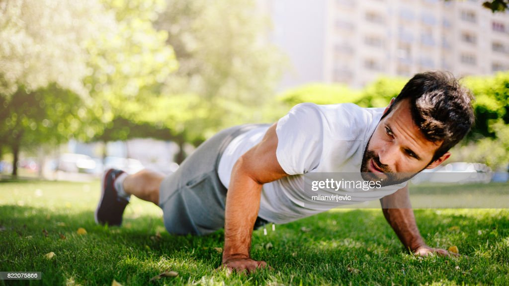 Morning training starts with pushups in nature : Stock Photo