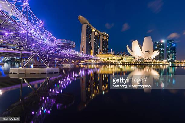 CONTENT] morning twilight blue hour of marina bay landmark with beautiful reflection in the Singapore River Singapore