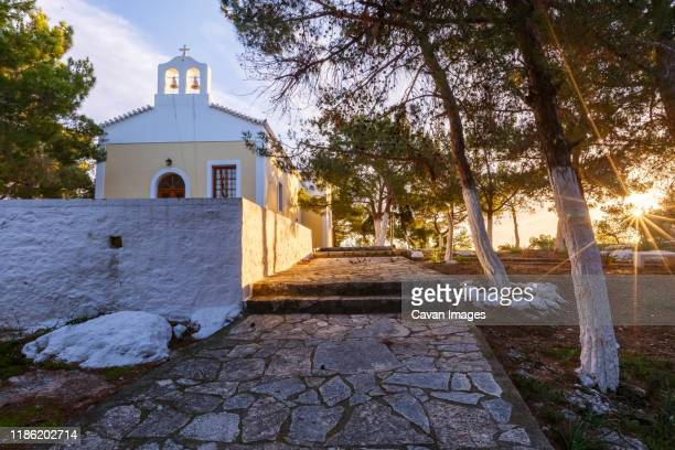 morning view of a church in spetses village, greece. - spetses stock pictures, royalty-free photos & images