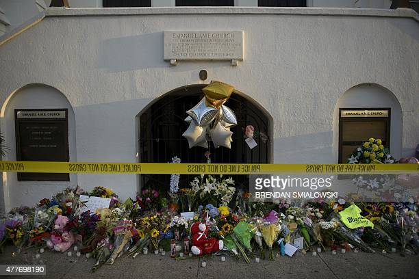 Morning view of a memorial outside the Emanuel AME Church June 19, 2015 in Charleston, South Carolina. US police arrested a white high school dropout...