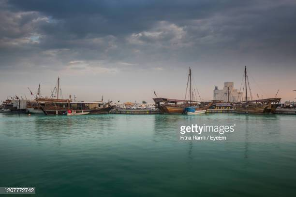 morning view of doha corniche, qatar, middle east. - quayside stock pictures, royalty-free photos & images