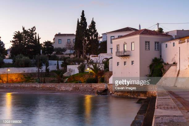 morning view of traditional architecture in spetses seafront, greece. - spetses stock pictures, royalty-free photos & images