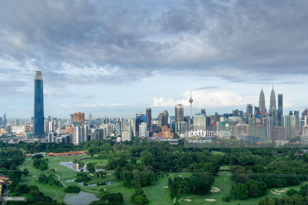 Morning view over Kuala Lumpur, capital of Malaysia. Its modern skyline is dominated by the 451m tall KLCC, a pair of glass and steel clad skyscrapers. : Stock Photo