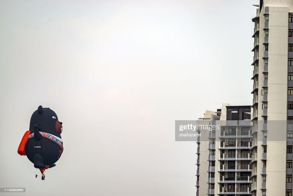 Morning view with hot balloons over condominium at Putrajaya. : Stock Photo