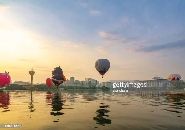 morning view with hot balloons over lake putrajaya, malaysia. - shaifulzamri stock pictures, royalty-free photos & images