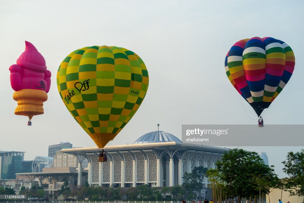 Morning view with hot balloons over lake Putrajaya, Malaysia. : Stock Photo