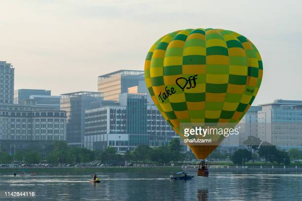 Morning view with hot balloons over lake Putrajaya, Malaysia.