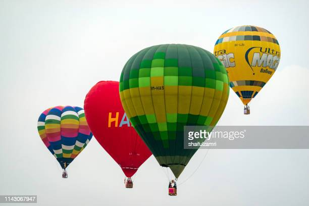 morning view with hot balloons over  putrajaya - shaifulzamri stock pictures, royalty-free photos & images