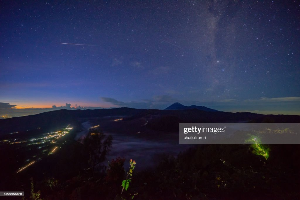 Morning view with Milky Way and meteor over Mount Bromo at Semeru Tengger National Park, East Java of Indonesia : Stock Photo